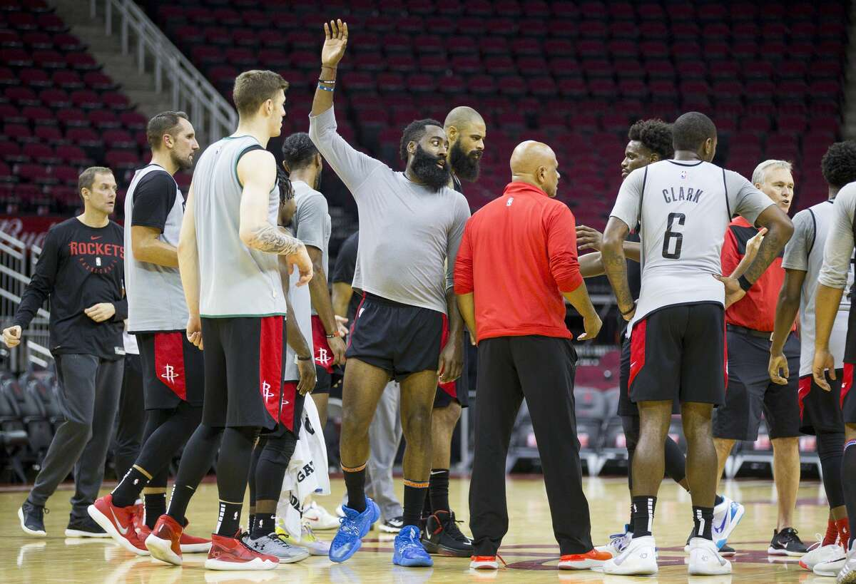 Houston Rockets guard James Harden high fives teammates during a Houston Rockets practice open to fans at Toyota Center in Houston, Monday, Oct. 14, 2019.