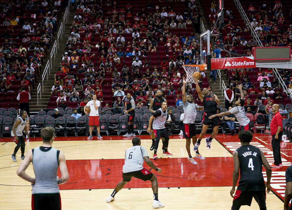 Fans watch during a Houston Rockets practice open to fans at Toyota Center in Houston, Monday, Oct. 14, 2019.