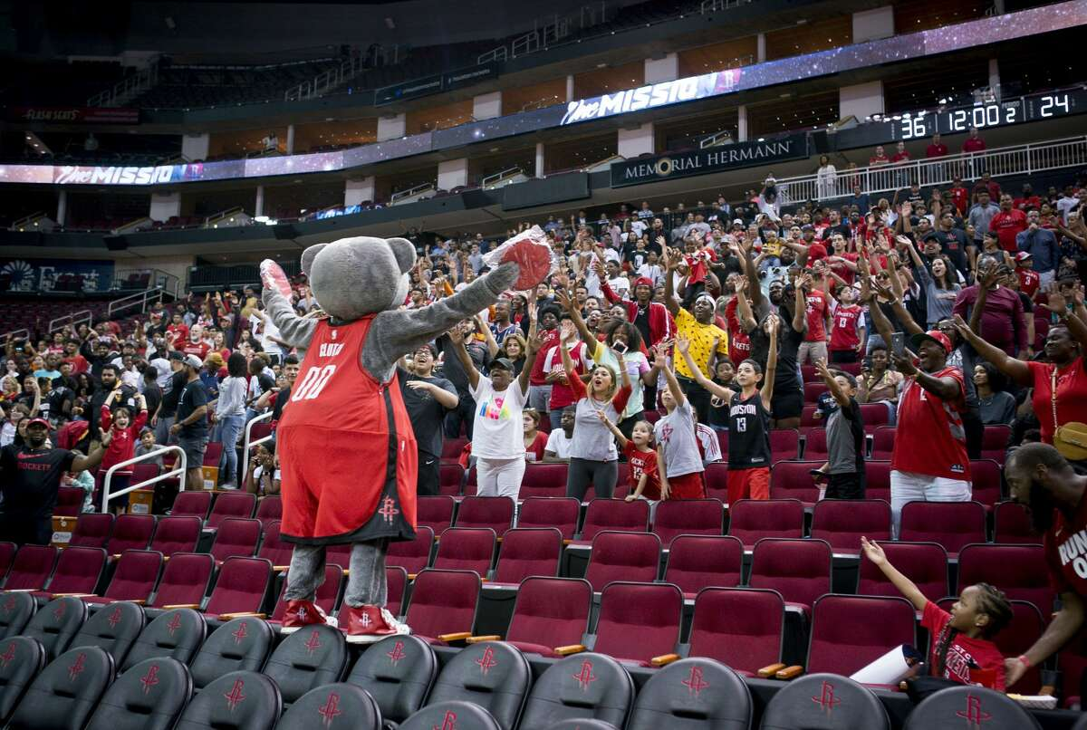 Fans cheer for Clutch during a Houston Rockets practice open to fans at Toyota Center in Houston, Monday, Oct. 14, 2019.