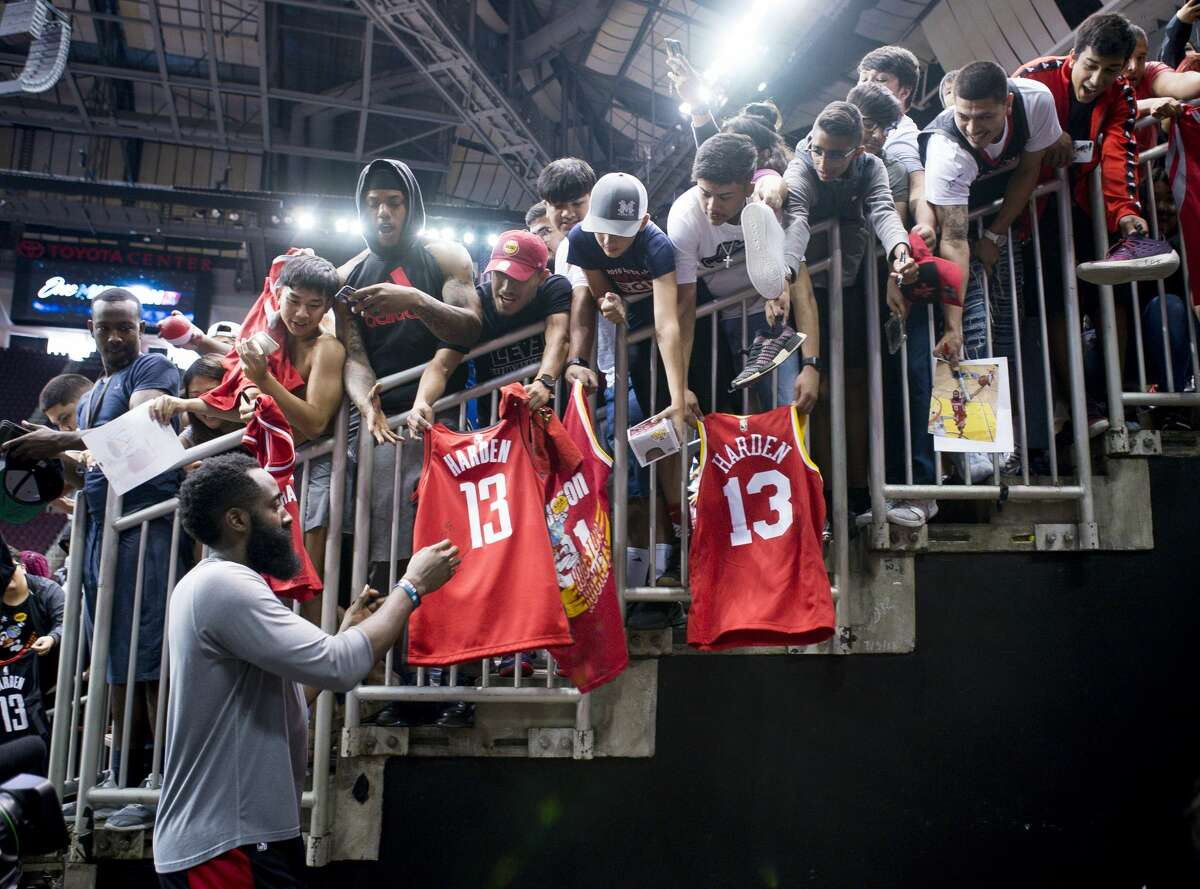Fans ask for autographs from James Harden during a Houston Rockets practice open to fans at Toyota Center in Houston, Monday, Oct. 14, 2019.