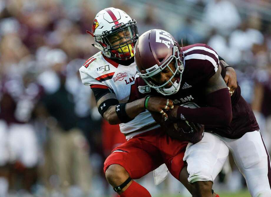Lamar Cardinals defensive back Michael Lawson (41) tackles Texas A&M Aggies wide receiver Jhamon Ausbon (2) during the first quarter of an NCAA game at Kyle Field Saturday, Sept. 14, 2019, in College Station, Texas. Photo: Godofredo A Vásquez, Houston Chronicle / Staff Photographer / © 2019 Houston Chronicle