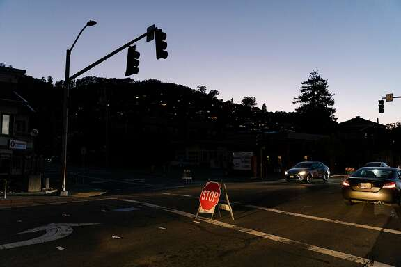 "A stop sign replaced a traffic signal while power was off in Sausalito, Calif., Oct. 9, 2019. Pacific Gas and Electric, intending to reduce the risk of wildfires during a wind event with dry conditions, cut power to many Northern California communities, but ""missteps"" led to communication failures, chaos and confusion when 700,000 homes and businesses lost electricity. (Jason Henry/ The New York Times)"