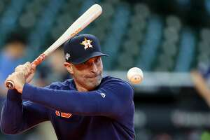 HOUSTON, TEXAS - OCTOBER 12:  Joe Espada #19 of the Houston Astros hits ground balls during batting practice prior to game one of the American League Championship Series against the New York Yankees at Minute Maid Park on October 12, 2019 in Houston, Texas. (Photo by Bob Levey/Getty Images)