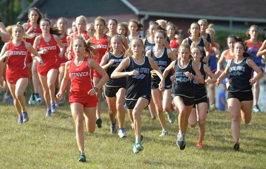 Race winner Mari Noble, left, from Greenwich, leads at the start of the girls cross country meet with Fairfield Ludlowe, Norwalk and Danbury on Sept. 11 at Tarrywile Park in Danbury. Photo: H John Voorhees III / Hearst Connecticut Media / The News-Times