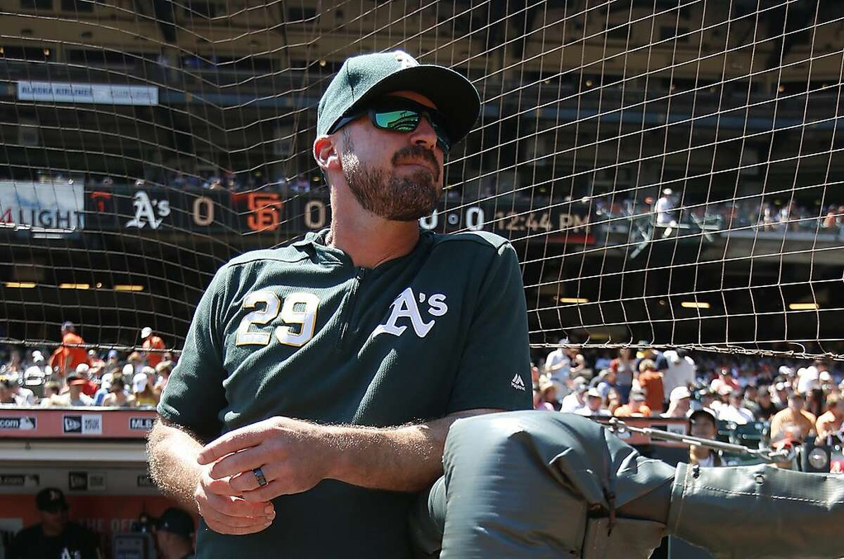 FILE - Bench Coach Ryan Christenson #29 of the Oakland Athletics stands in the dugout prior to the game against the San Francisco Giants at Oracle Park on August 14, 2019 in San Francisco, California.
