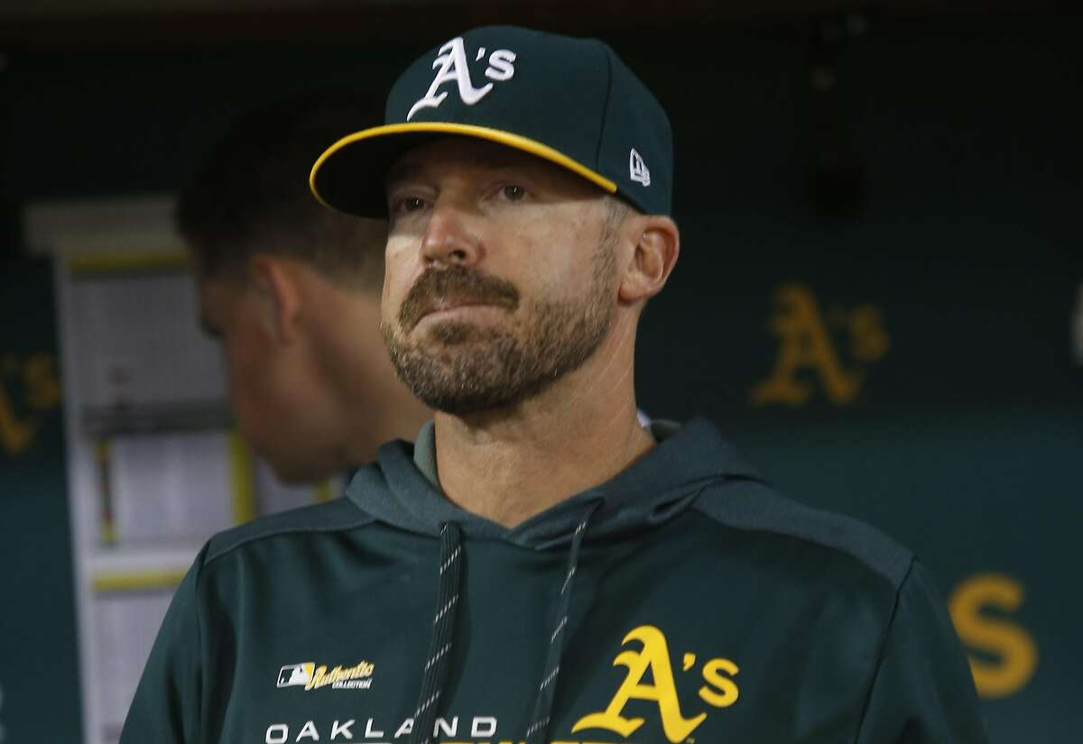 FILE: Bench Coach Ryan Christenson #29 of the Oakland Athletics stands in the dugout during the game against the Texas Rangers at the Oakland-Alameda County Coliseum on April 22, 2019 in Oakland.