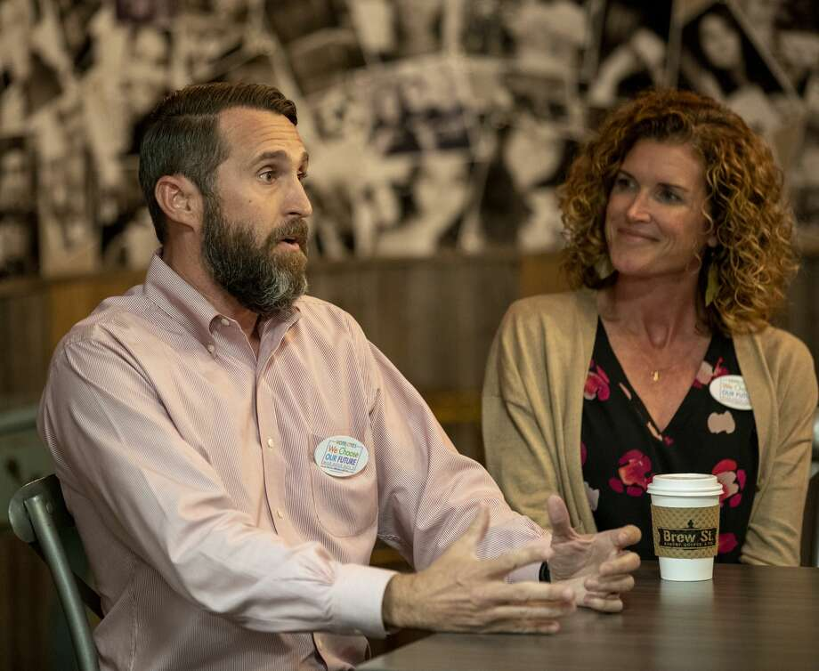 Dave Joyner, left, and Christine Foreman discuss the MISD bond Monday, Oct. 14, 2019 at Brew St. Bakery.  Jacy Lewis/Reporter-Telegram Photo: Jacy Lewis/Reporter-Telegram