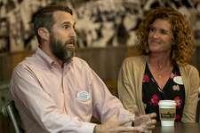 Dave Joyner, left, and Christine Foreman discuss the MISD bond Monday, Oct. 14, 2019 at Brew St. Bakery. Jacy Lewis/Reporter-Telegram