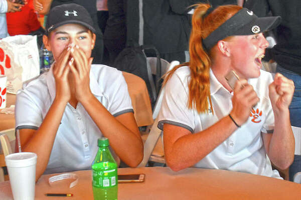 Edwardsville's Nicole Johnson, left, and Riley Lewis react to the Tigers winning the Class 2A O'Fallon Sectional championship.