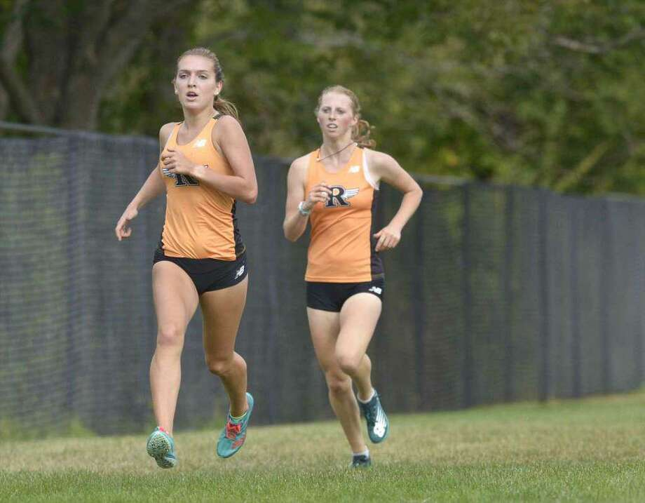 Senior Tess Pisanelli (left) and sophomore Katie Rector have been the top-two runners for the unbeaten Ridgefield girls cross country team. Photo: H. John Voorhees III / Hearst Connecticut Media
