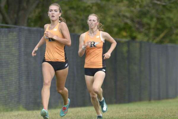 Senior Tess Pisanelli (left) and sophomore Katie Rector have been the top-two runners for the unbeaten Ridgefield girls cross country team.