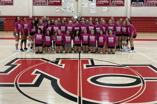 The New Canaan Rams wear their Dig Pink t-shirts in the NCHS gym. The volleyball team will be hosting a fundraiser for the Side Out Foundation, helping to raise money and awareness for the fight against breast cancer, on Tuesday, Oct. 15.