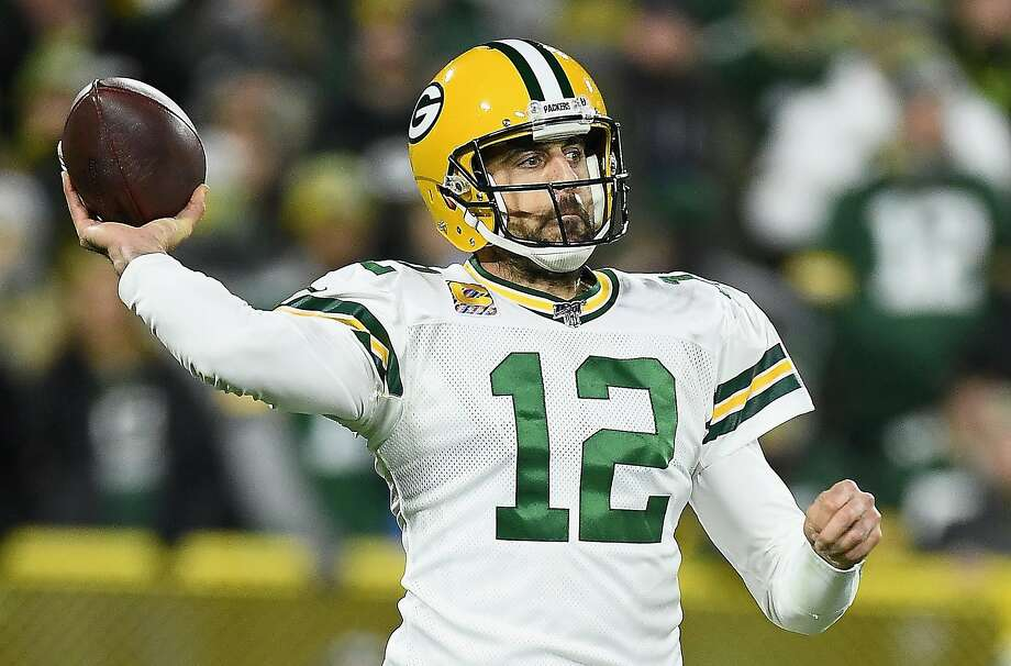 GREEN BAY, WISCONSIN - OCTOBER 14: Quarterback Aaron Rodgers #12 of the Green Bay Packers looks to pass against the defense of the Detroit Lions during the game at Lambeau Field on October 14, 2019 in Green Bay, Wisconsin. (Photo by Stacy Revere/Getty Images) Photo: Stacy Revere / Getty Images