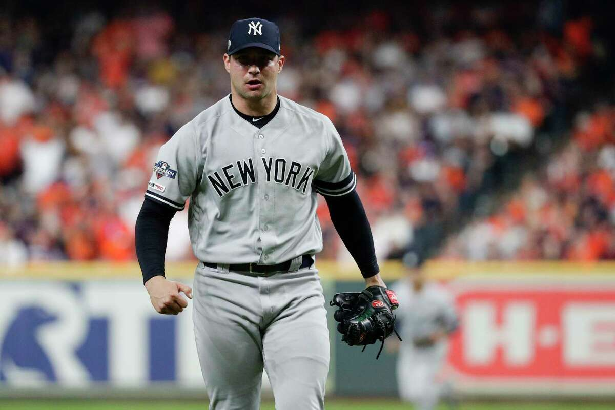 New York Yankees relief pitcher Tommy Kahnle celebrates after striking out the final batter of the fifth inning in Game 2 of baseball's American League Championship Series against the Houston Astros Sunday, Oct. 13, 2019, in Houston. (AP Photo/Eric Gay)