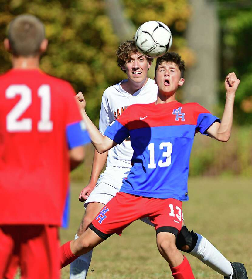 Maple Hill's Eli Charlebois, right, heads the ball defended by Cambridge's Jeffrey Burke during a soccer game on Monday, Oct. 14, 2019 in Castleton, N.Y. (Lori Van Buren/Times Union) Photo: Lori Van Buren / 20048003A
