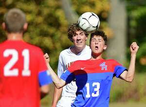 Maple Hill's Eli Charlebois, right, heads the ball defended by Cambridge's Jeffrey Burke during a soccer game on Monday, Oct. 14, 2019 in Castleton, N.Y. (Lori Van Buren/Times Union)