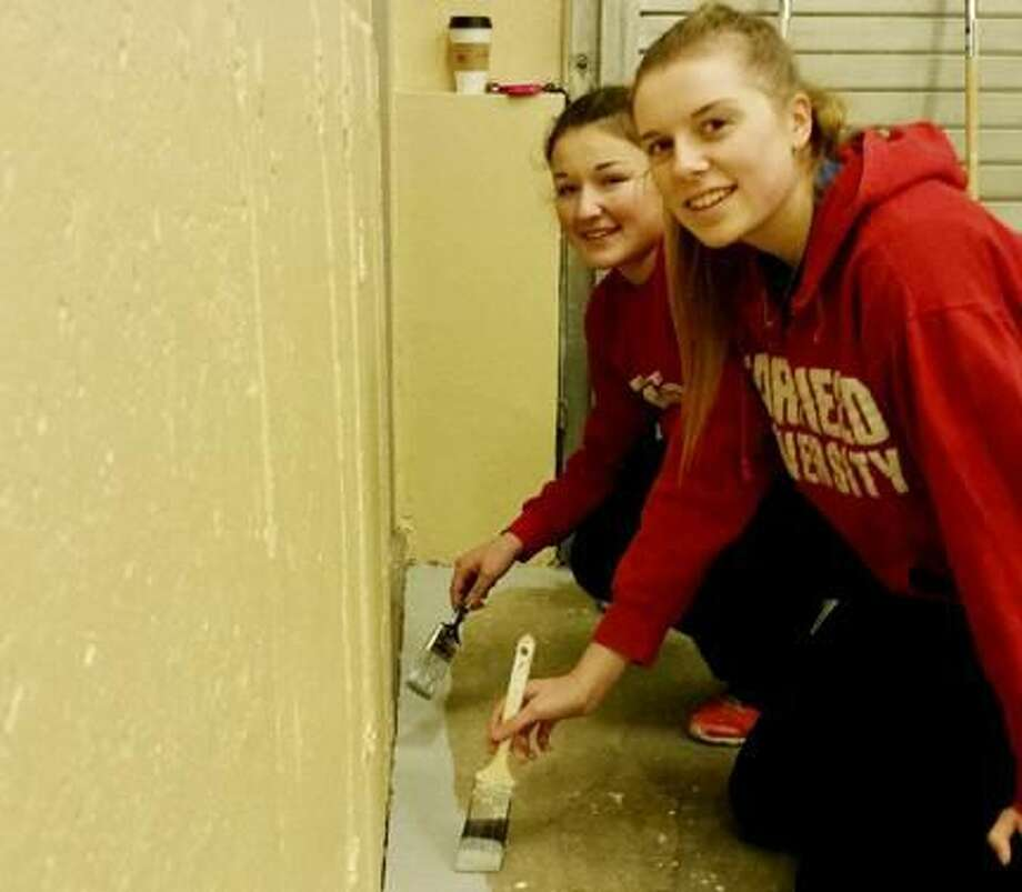Submitted Photo Left to right, Olivia Dowgiewicz and Hannah Clark paint the floor.