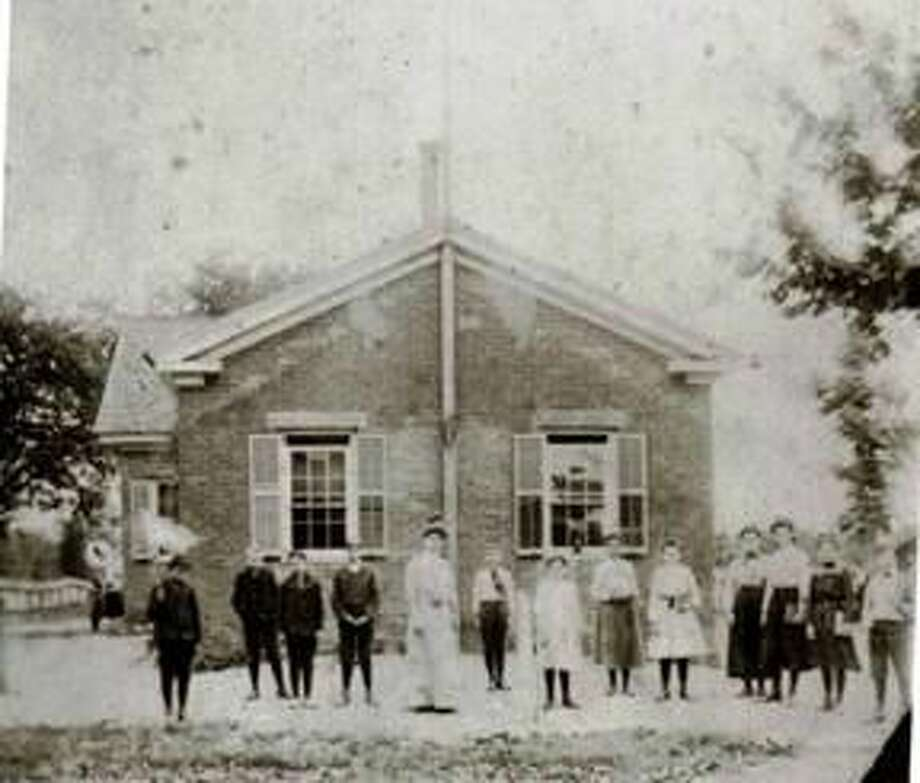 Submitted Photo A teacher and her students are shown outside Montowese School in 1904.