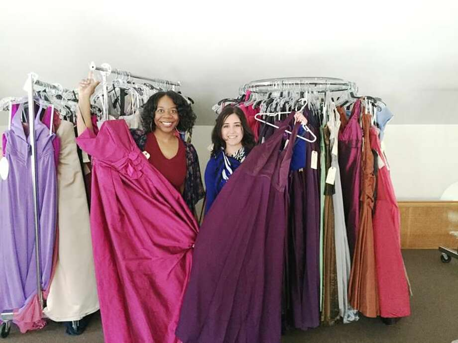 Submitted photo Khalilah Abdulrahim, of Project Hope CT, and Laura Andrews, of SARAH Inc., display free prom dresses at a donated storefront at 286 York Street in New Haven.