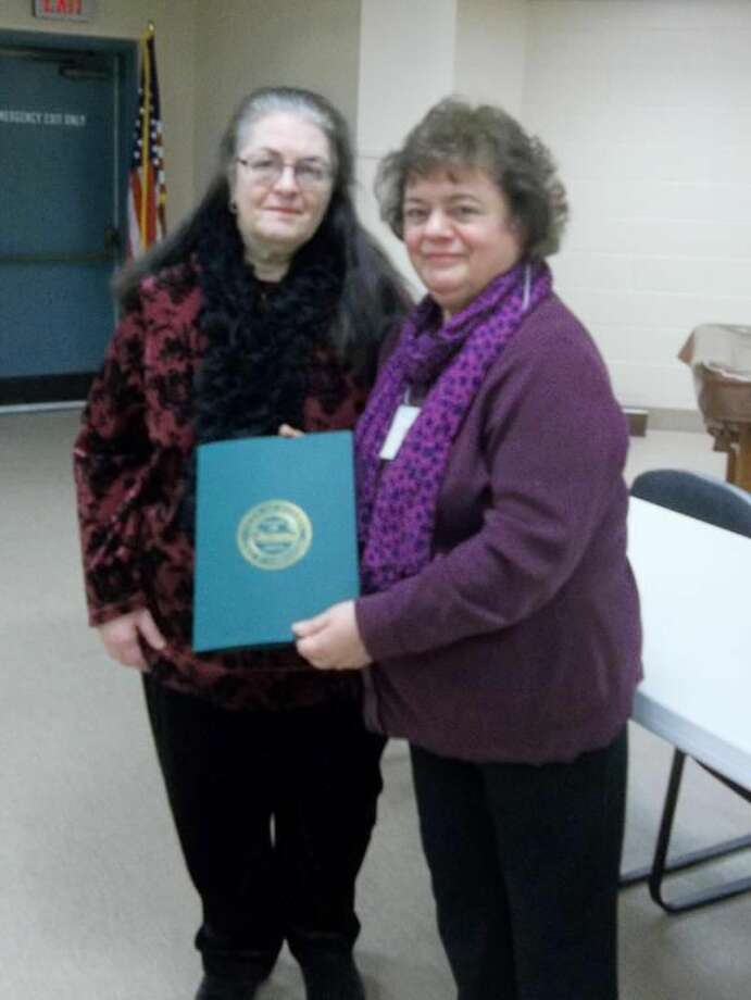 Submitted Photo Barbara Aurora, right, is presented a proclamation from Town Clerk Vera Morrison.