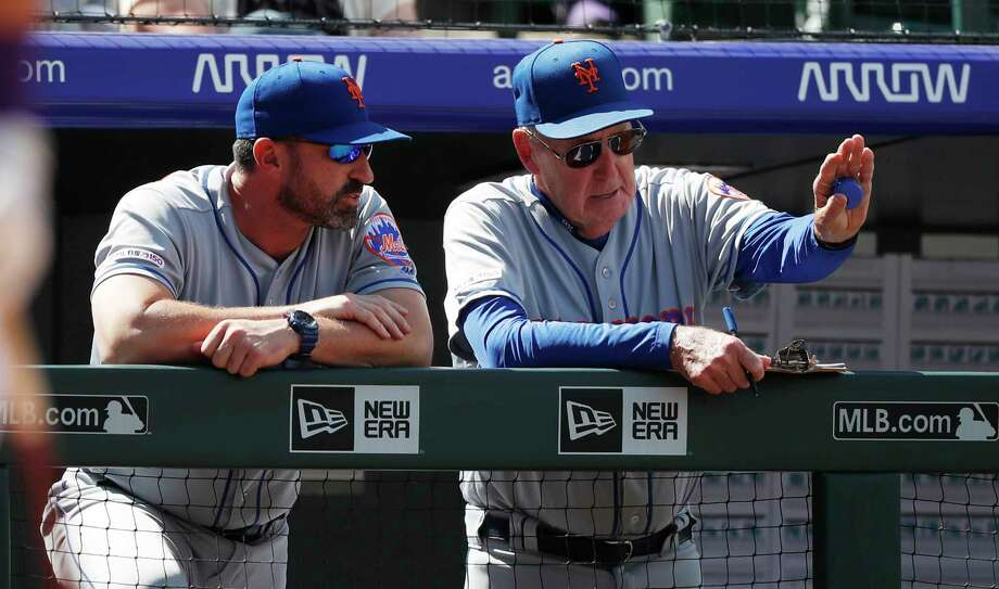 New York Mets interim pitching coach Phil Regan, right, confers with manager Mickey Callaway in the second inning of a baseball game against the Colorado Rockies Wednesday, Sept. 18, 2019, in Denver. (AP Photo/David Zalubowski) Photo: David Zalubowski / Copyright 2019 The Associated Press. All rights reserved.