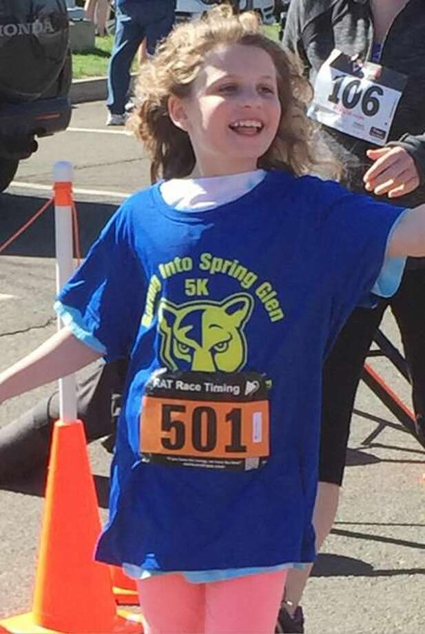 Submitted Photo by Marc Goldberg Allison Goldberg, 9, was thrilled to complete the first Spring Into Spring Glen 5K road race on April 19. The event was both a fundraiser for Spring Glen School's PTA and a community fun run.
