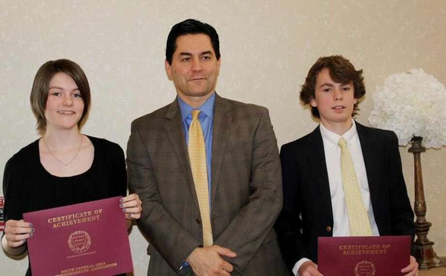 Submitted Photo South Central Area Superintendents Association Award winners Hannah Fruin, left, and William Ryan, right, are joined by school principal Philip Piazza at the awards banquet at Cascades in Wallingford on March 13.