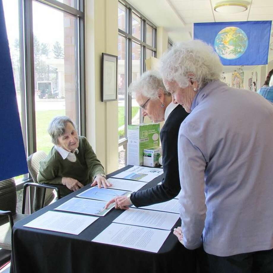 Submitted Photo Conservation-Nature Committee member Dorothy Singer talks with residents Joan Stone and Mary Alice Frankenberger.