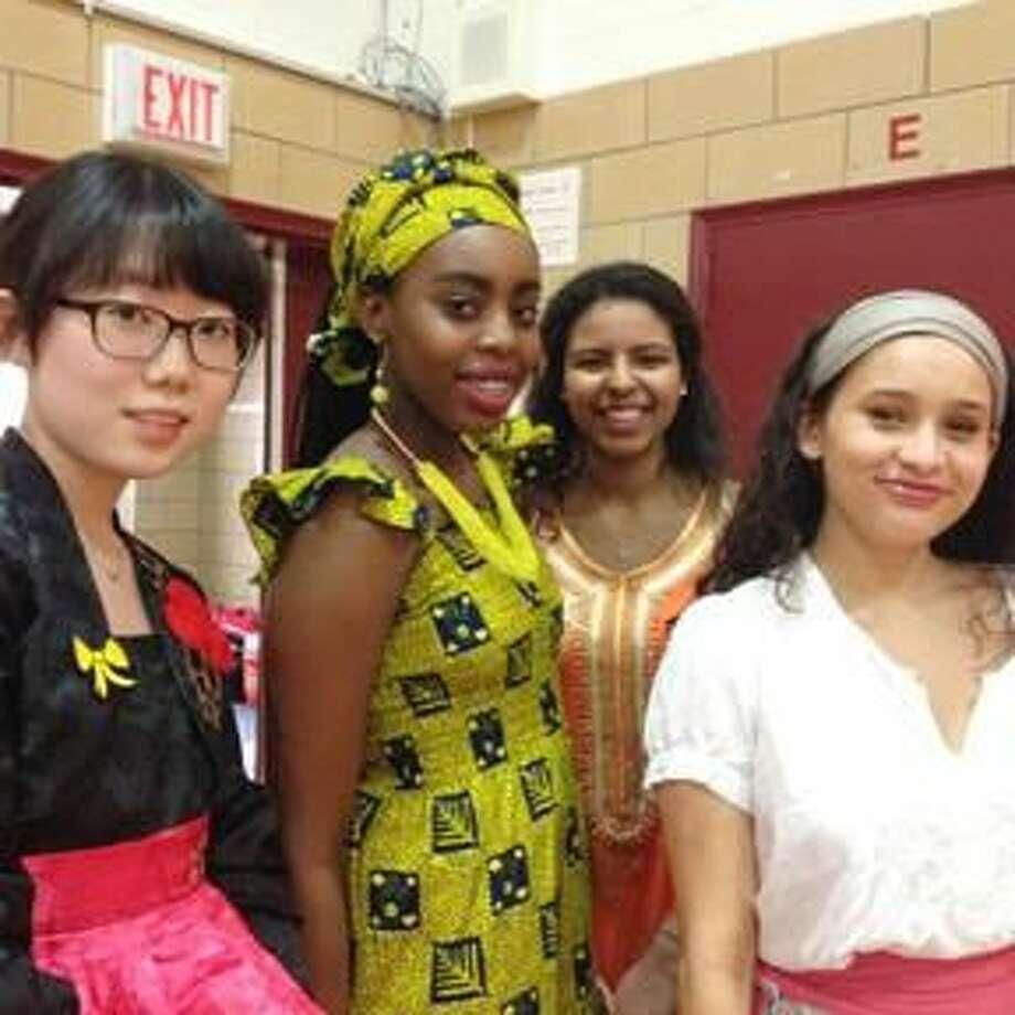 "Submitted Photo Eunyee Cho '16 of Hamden, Joy Alino '16 of Cheshire, Ayah Elarabi '16 of Hamden, and Andrianna Ayala '16 of Orange prepare for the ""Shades"" of SHA Fashion Show."