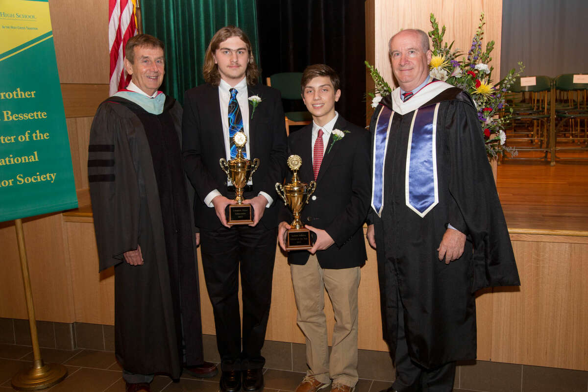 Submitted Photo From left, Notre Dame President Brother James Branigan, salutatorian Cameron Hines, valedictorian Andrew Jefferies, and Principal Patrick Clifford pose for a picture following Honors Night on May 14.