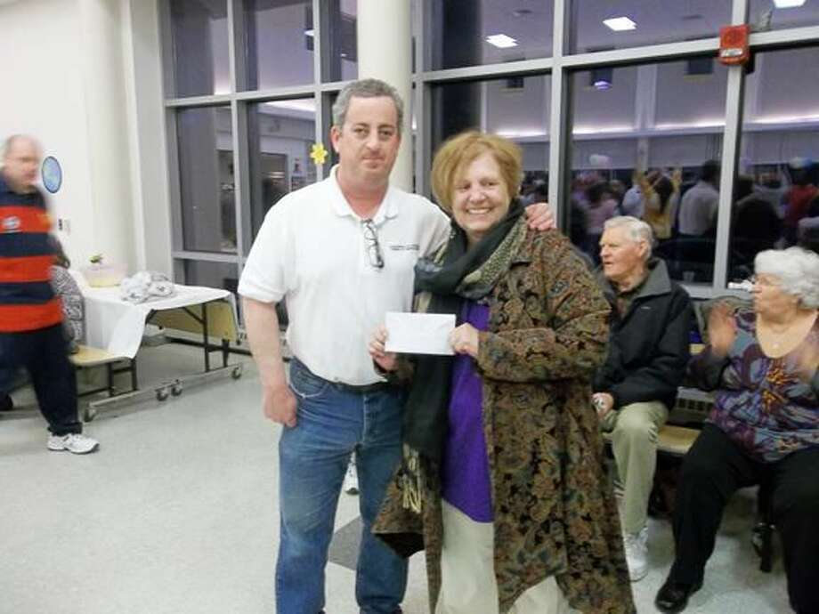 Submitted Photo Chris Balogh, Disabilities Commission Chair, presents a check to Mischa Campbell, Local Coordinator for of Hamden New Haven Special Olympics.