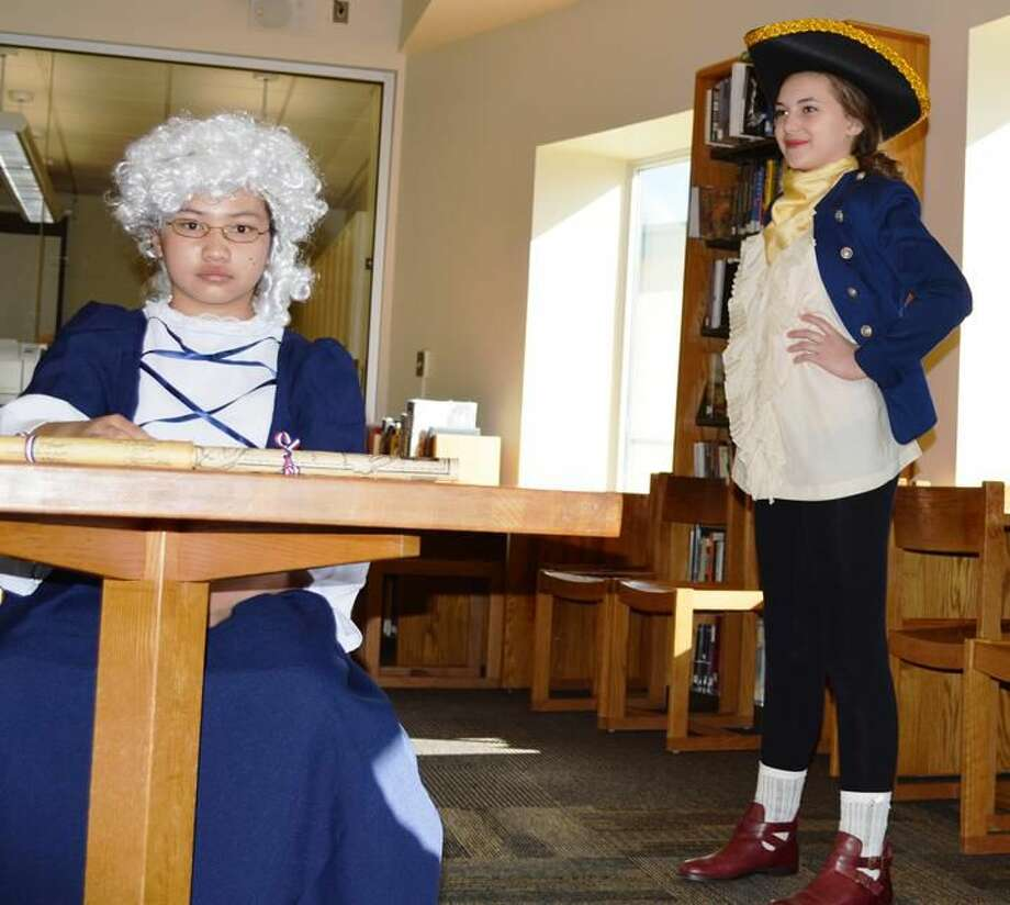 Submitted Photo Hamden Hall Country Day School fifth-graders Olivia Kuselias of Hamden and Sandra Apfelroth of Norwalk were transformed into George and Martha Washington, respectively, as part of a living history museum on exhibit in the school's Swain Library.