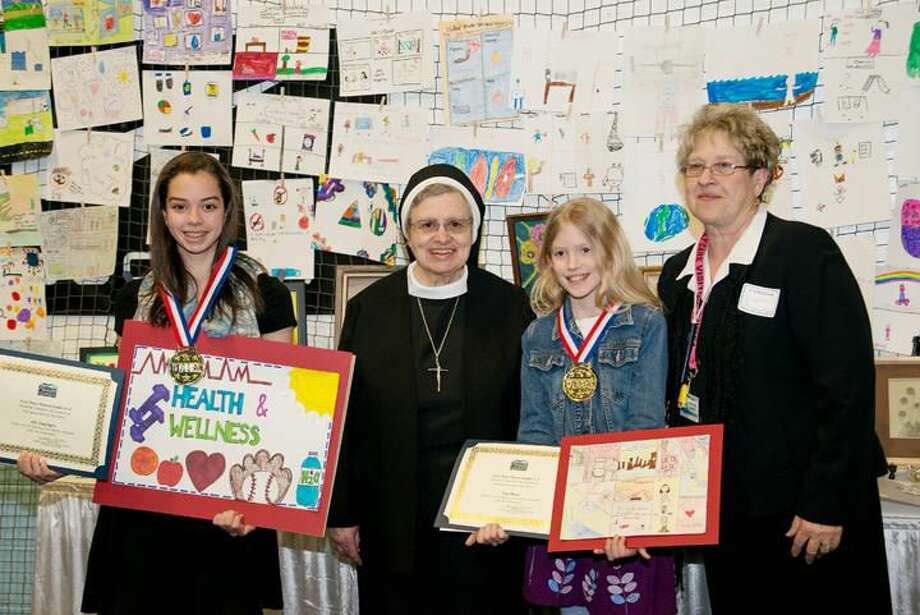 Submitted Photo From left, Ally Engengro, Sister Anne D'Alessio, Gigi Boyce and Josephine Marra enjoyed the art competition at the 11th Annual Business & Community Expo presented by the Hamden Regional Chamber of Commerce earlier this month. The youngsters attend St. Rita's School where they created artwork based on the theme: What does health & wellness mean to you? D'Alessio is the school's assistant principal and Marra coordinates the annual competition on behalf of Whitney Manor Rehabilitation and Nursing Center.