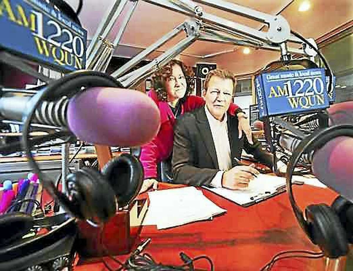 Pam Landry, WQUN-AM operations manager with radio personality Brian Smith, formerly of WPLRs Smith & Barber show, at the WQUN studios in Hamden.