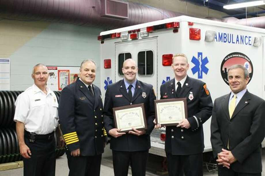 Submitted Photo Pictured at the award ceremony, held in New Haven are L-R Deputy Chief David Marcarelli, Chief Vincent Landisio, Firefighter Ben Fox, Lieutenant Scott Martus and First Selectman Michael Freda.