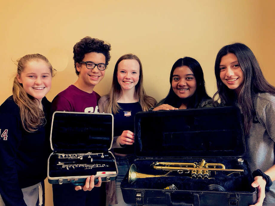 "These Sophomores, from North Haven High School, along with one other sophomore, Molly Coyle(not pictured), have been spearheading the ""Spreading the Music Project,"" with the initiative to better their community by passing down instruments in their community. (Pictured from left to right) Carly Fresher, Diego Esponda, Kayleigh Meehan, Elliza Sayed, and Olivia Stefanik."