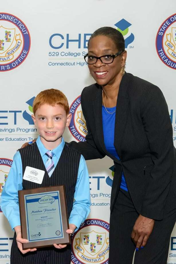 Submitted Photo by Nick Caito Matthew Fleischer a student from Hamden was among the 84 statewide winners of this year's CHET Dream Big! Matthew is pictured accepting his award from State Treasurer Denise L. Nappier.