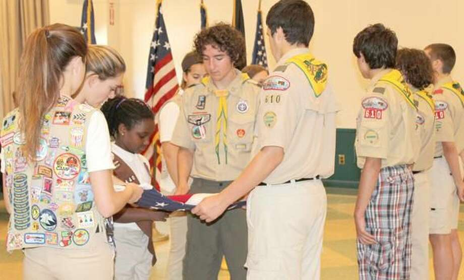 Submitted Photo Local Scouts and Elk members gather following the annual Flag Day Ceremony held at the Hamden Elks Lodge #2224.