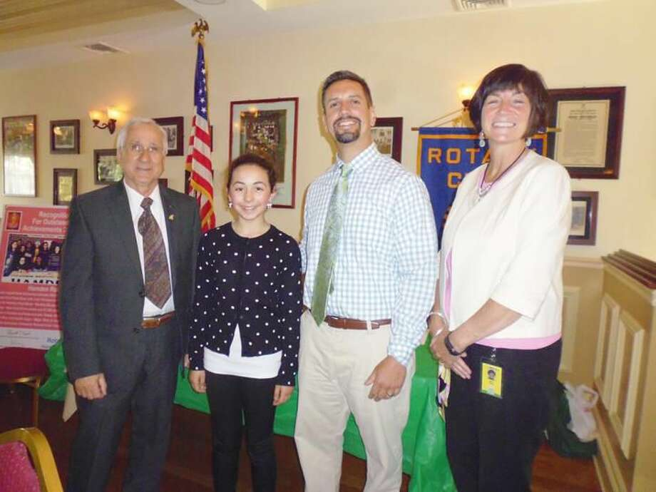 Submitted Photo From left, Hamden Rotary Club President Lee Campo, student Lily Torello, Bear Path School Principal Scott Trauner, and teacher Mary Dunn.