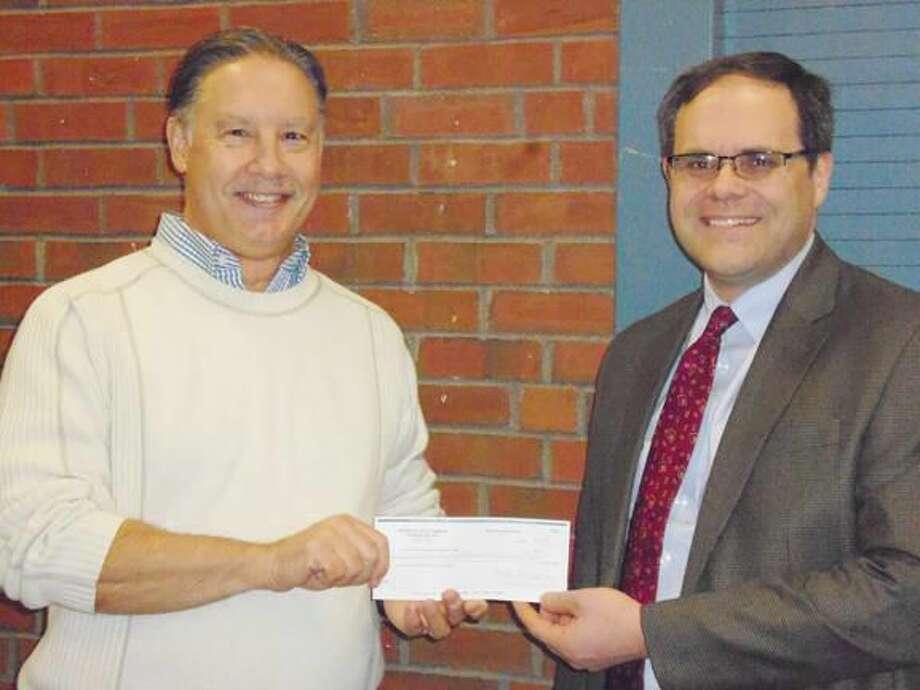 Submitted Photo Robert J. Freeman, Jr. Deputy Director of Emergency Management, accepts the check from Hamden Rotarian Paul Begemann