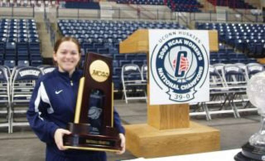 Hamden native Kristen Altieri holds the 2009 women's basketball national trophy.
