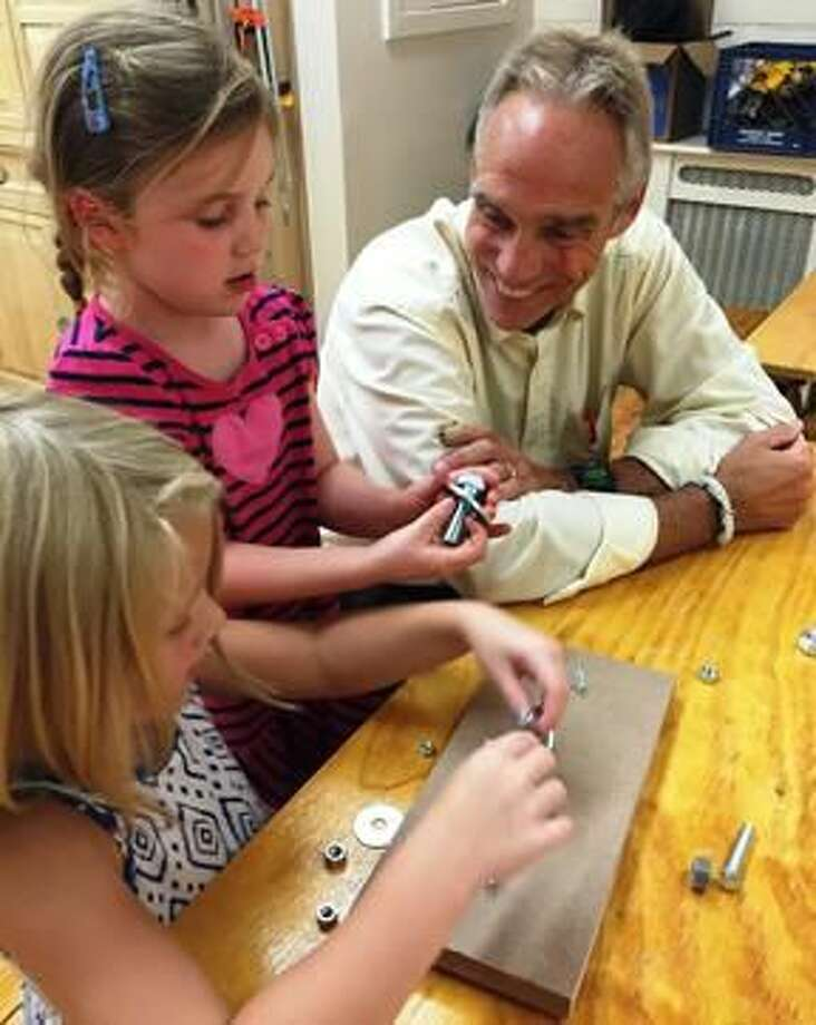 Submitted Photo Hamden Hall Country Day School kindergartners enjoyed a hands-on, small motor skill activity last week with science teacher and MakerSpace Director Dave Bennett in the school's new MakerSpace Design Lab.