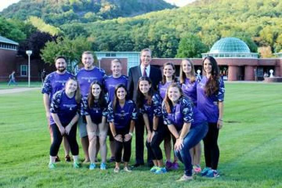 Submitted photo Quinnipiac University students gather with President John L. Lahey before Relay for Life on Sept. 11-12. Back row, from left are: Grant Arnold, Christopher Aldarelli, Matthew Morris, Quinnipiac President John L. Lahey, Abbie O'Neill, Alexis Smith and Jenna Muscarella. Front row, from left are: Danielle Joyce, Alena Breton, Kathryn Pereira, Amanda Ruggieri and Julianne Darcey.