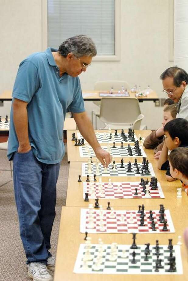 Photo by Peter Casolino Nelson Castaneda, a FIDE ranked chess master, plays 25 simultaneous games against students who participated in the Annual Chess Master Simultaneous Exhibition.