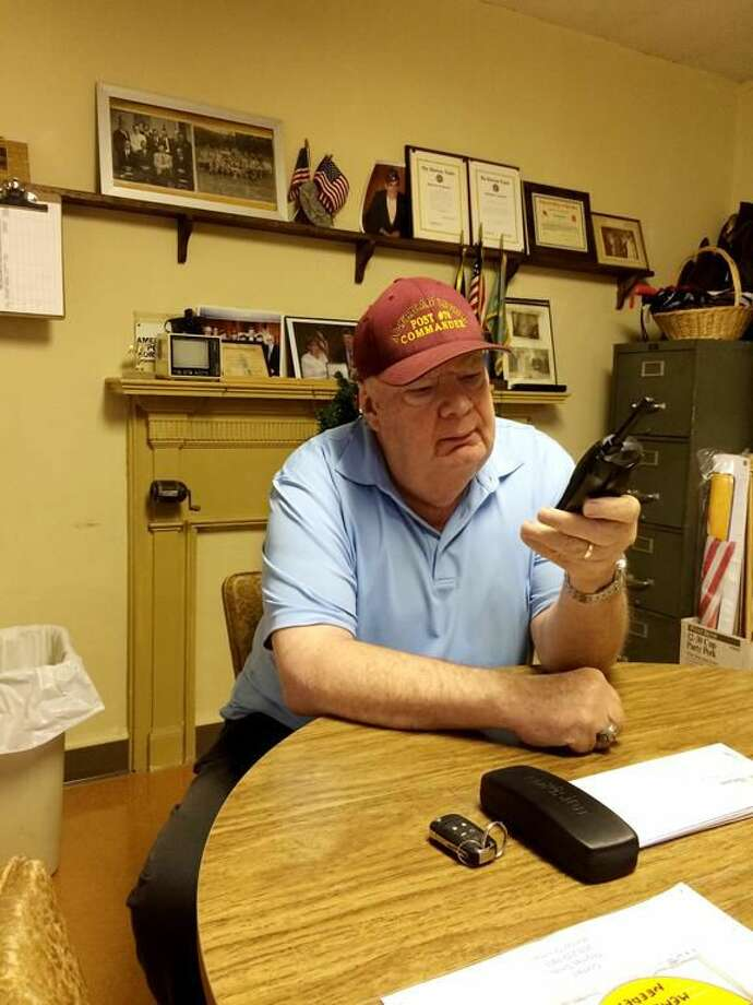Photo by Lynn Fredricksen Recently retired Dan Riccio has a very full schedule of veterans' activities on his calendar. Here, he wraps up a phone call at American Legion Hall where he serves as Commander.