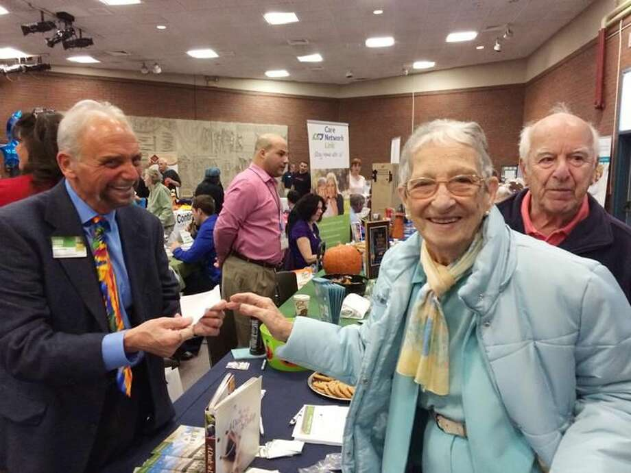 Photo by Lynn Fredricksen Rose Mattia and her husband, James Mattia, both of Hamden and Florida, visited the Health & Lifestyle Festival for Seniors and their Caregivers at Thornton Wilder Auditorium last week. Here, they are chatting with John Ardolino of Atria Larson Place.