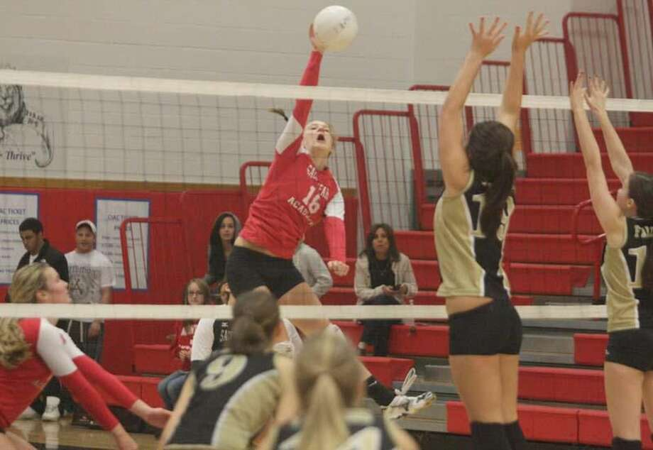 Sacred Heart junior Clare Kane goes up for the kill against Joel Barlow. (Photo by Russ McCreven)