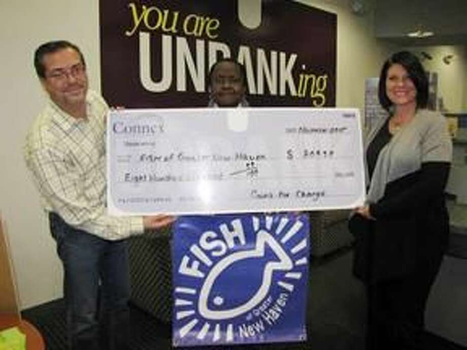 Submitted Photo Nelson North, assistant branch manager, Connex Credit Union's Hamden Branch, left, presents liaison for FISH of Greater New Haven Inc., Wanda Harris, center, and Joy Johannes, executive director, FISH of Greater New Haven Inc., with a check for $809.39. The funds were raised through Connex's Coins-for-Change program.