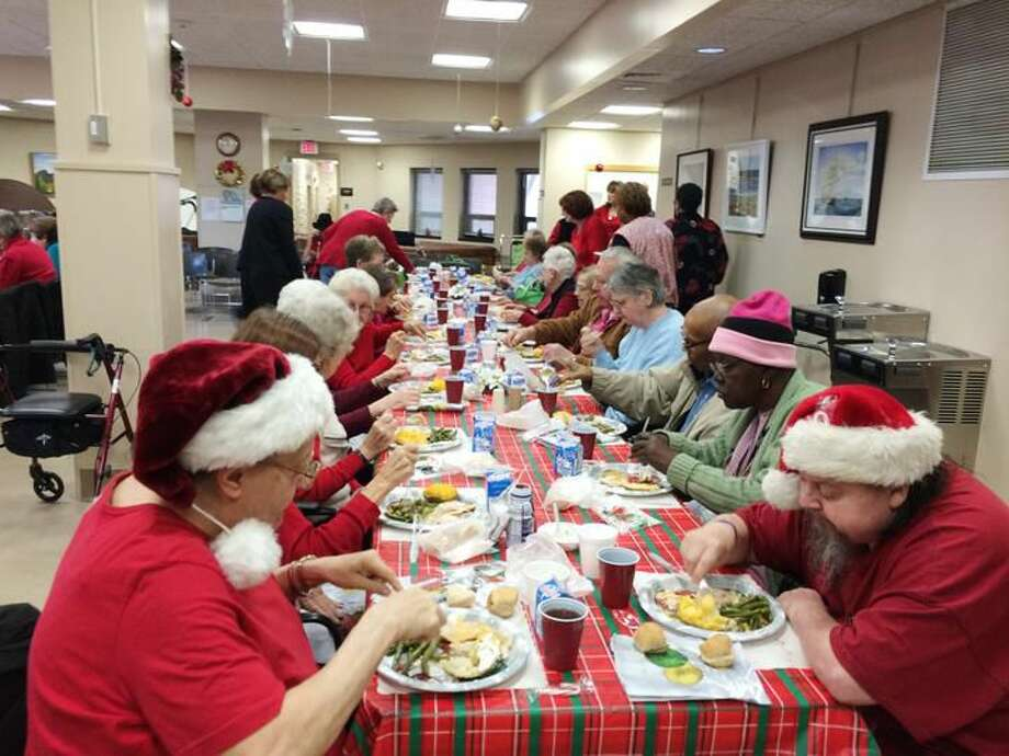 Photo by Lynn Fredricksen Seniors citizens were treated to a festive Christmas celebration at the Miller Senior Center in Hamden on Friday. In addition to visit from Santa and some carolers, one of the highlights of the event was a turkey dinner.