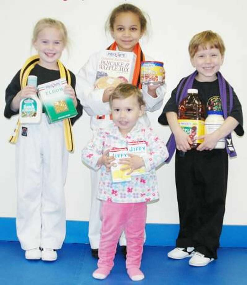 Submitted Photo Pictured back row from left: Jordan Wieland, Gabriella Rodriguez and Gabriel Ciarleglio. In front is Hailey Ciarleglio. The children at the Academy Of Kempo Martial Arts are learning at a young age how to help others and to be part of a community.